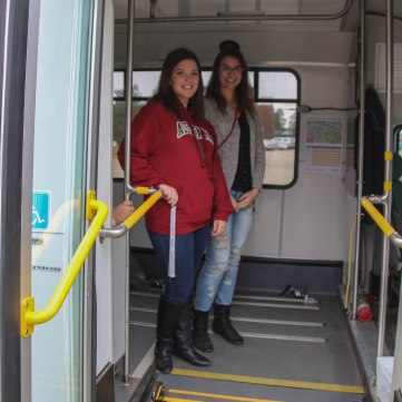 Local students check out the Camrose Community Bus. We can assure you that Ms. Frizzles' got nothin' on this wild ride!