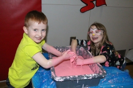 Children play in slime during the annual Rocky Road event at the Augustana gymnasium Jan. 27.