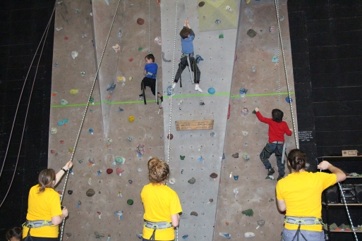 Children learn how to use the climbing wall during the annual Rocky Road event in the Augustana Gymnasium Jan. 27.
