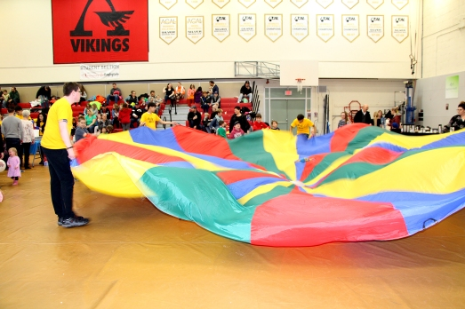 Augustana students and visiting Camrose children play with the big parachute during the annual Rocky Road event in the Augustana Gymnasium Jan. 27.